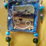 Landscape brooch with beads and roses